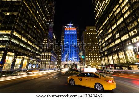 Park Avenue, New York City, April 8, 2016. Park avenue ar night with its illuminated buildings - stock photo