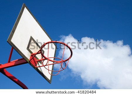 Park basketball ring close up and blue sky. - stock photo