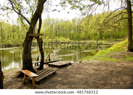 park bench at the peacefull silent lake