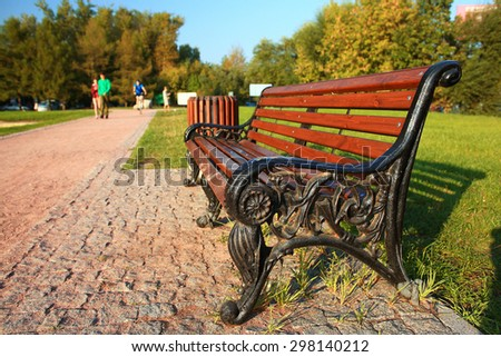 Park bench autumn urban landscape recreation