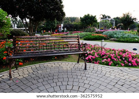 Park Bench in a flower garden.