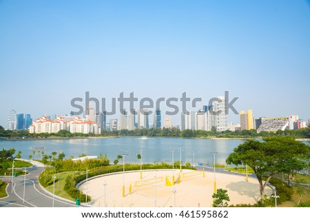 Park in Singapore. Lakes and high-rise buildings in the city in the background.