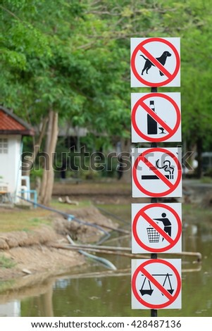 Park prohibited signs and ecology warnings - stock photo