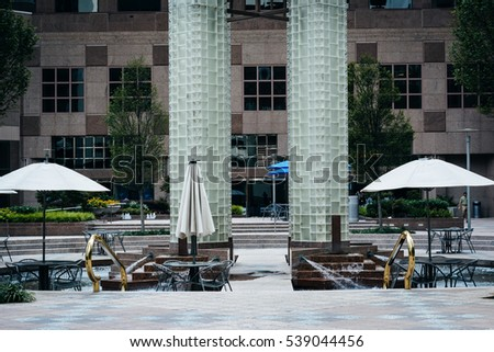 Park with fountain and tables in Uptown Charlotte, North Carolina.