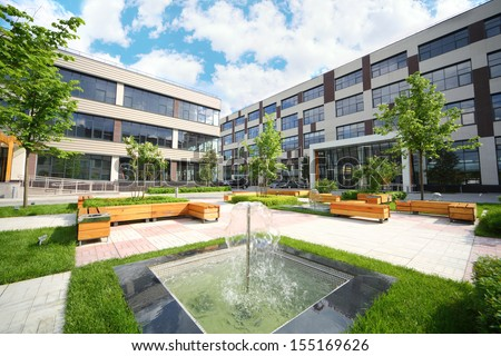 Park with fountains and benches in front of the Business Center - stock photo