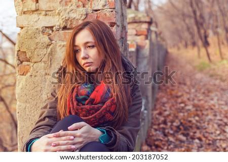 Park woman sadness autumn loneliness - stock photo