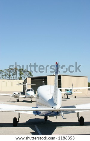parked airplanes - stock photo