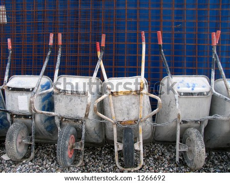 Parked and chained wheel barrows after work. - stock photo
