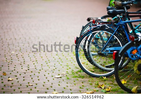 Parked Bicycles On Sidewalk. Bike Bicycle Parking On The Street - stock photo