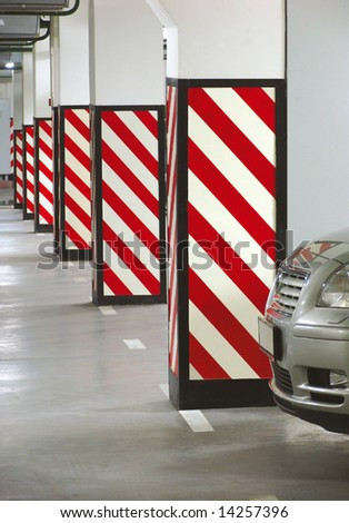 Parked car in the underground garage - stock photo