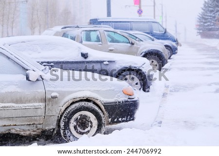 Parked cars in the snow - stock photo