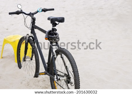 Parked on a sandy beach Bike - selective focus - isolated object - stock photo