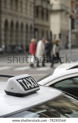 Parked taxi car roof detail - stock photo