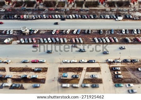 Parking and traffic on the city road - stock photo