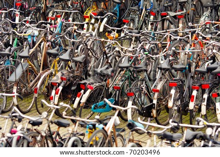 Parking bikes in Amsterdam,Netherlands,shallow focus - stock photo