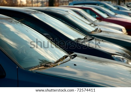Parking cars in a row - stock photo
