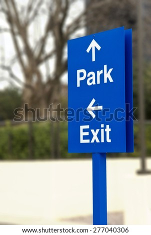 Parking Directions/  Blue Sign Showing Parking Direction Parking Symbols - stock photo