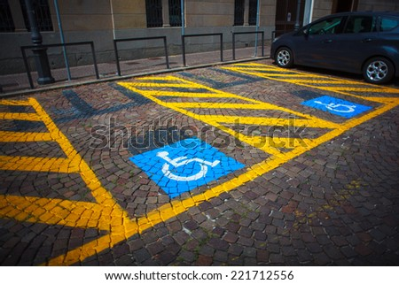 Parking for cars and signal for the disabled - stock photo