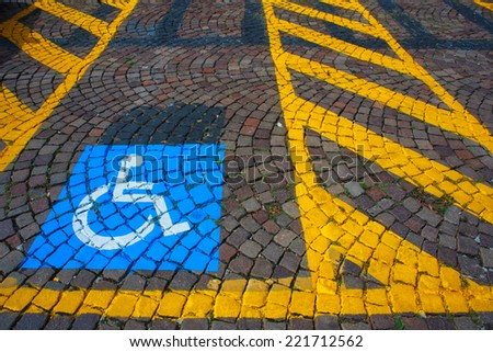 Parking for cars and signal for the disabled