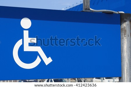 Parking for disabled persons sign. White on blue.       - stock photo