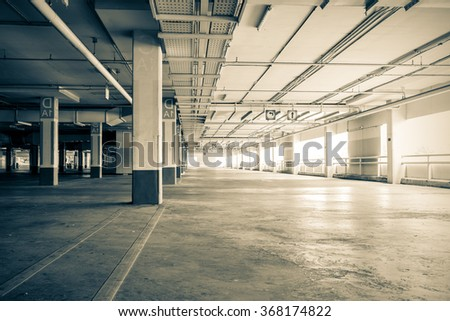 Parking garag interior, industrial building,Empty underground parking background,vintage tone - stock photo