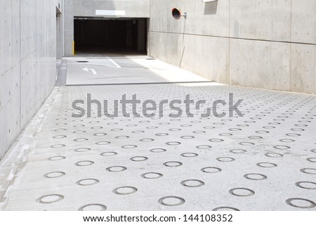 Parking garage entrance basement - stock photo