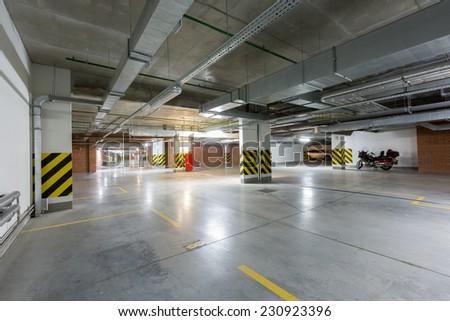 Parking garage underground, industrial interior - stock photo