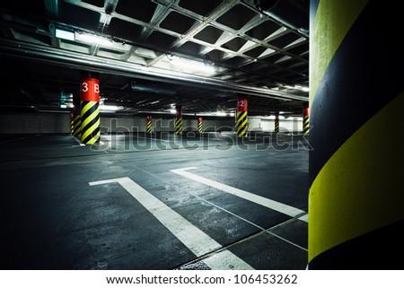 Parking garage underground, industrial interior. Neon light in bright industrial building. - stock photo