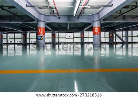 Parking garage underground, industrial interior, shanghai china. - stock photo