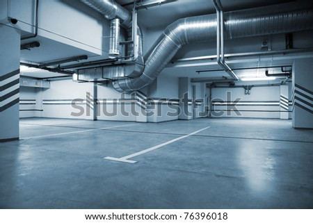 Parking in a cellar of a modern building - stock photo