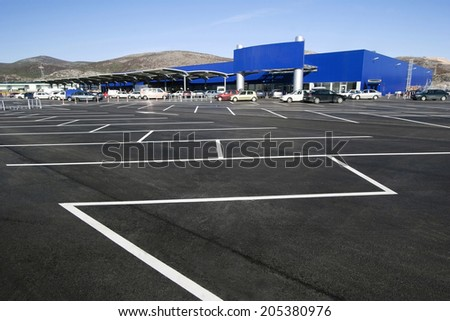 Parking lot in the shopping mall - stock photo