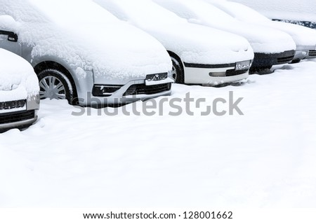 Parking lot in winter storm - stock photo