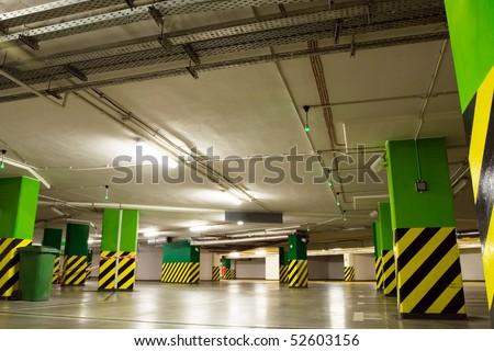 Parking lot, underground garage of shopping center. Neon light in bright industrial building. - stock photo