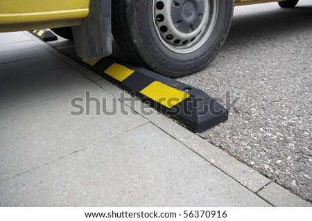 Parking place with yellow signs and car