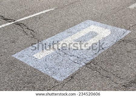 Parking sign on the asphalt, detail signal circulation - stock photo