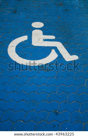 Parking space for Handicapped with wheelchair symbol on blue paint