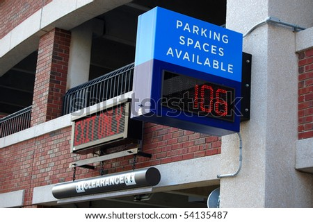 Parking structure entrance with number of spaces available - stock photo