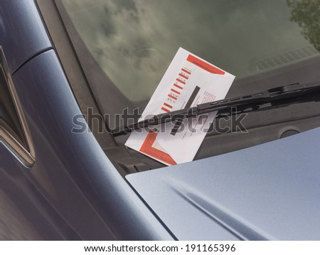 parking ticket on motor car windscreen or windshield.  - stock photo