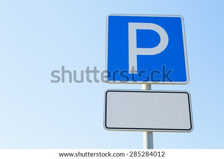 Parking with a sign on blue sky  - stock photo