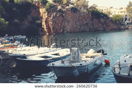 Parking wooden boats in the bay on the island - stock photo