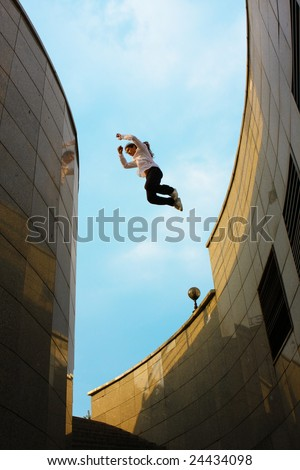 parkour, people jumping from buildings - stock photo