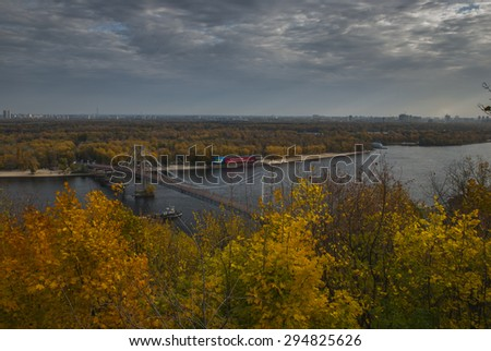 Parkovy Pedestrian Bridge crossing the river Dniper during Autumn in Kiev - stock photo