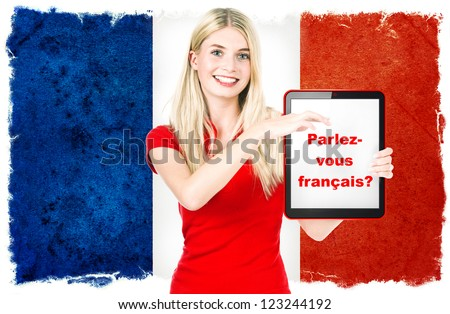 Parlez-vous francais? young woman holding tablet pc on the background with french national flag. french language learning concept - stock photo