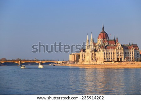 Parliament building and Danube river under the Margaret Bridge at evening, Budapest, Hungary - stock photo