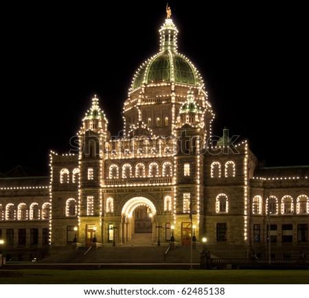 Parliament building illuminated at night, Victoria, British Columbia. - stock photo