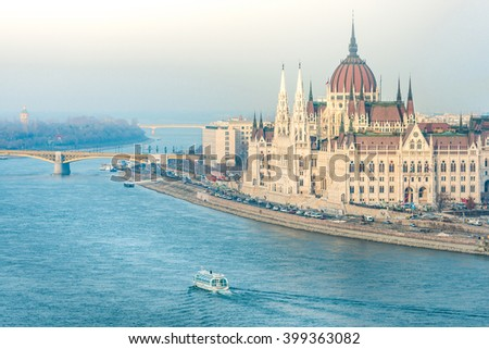 Parliament building in Budapest, Hungary, Europe. Blue water of Danube river. Major Landmark and tourist attraction. - stock photo