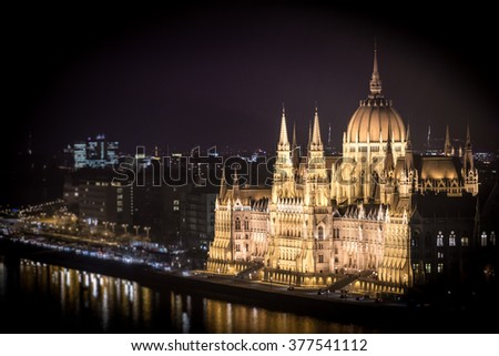Parliament building in Budapest, Hungary, Europe. Night in city. Lights reflecting in waters of Danube river. Major Landmark and tourist attraction. - stock photo