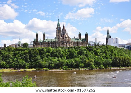 Parliament Buildings and Library, viewed across Ottawa River, Ottawa, Ontario, Canada - stock photo