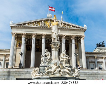 "parliament in vienna, austria. with the statue of ""pallas athene"" the greek goddess of wisdom."