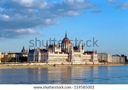 parliament of budapest and river danube at sunset - stock photo